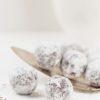 Truffle candies with sugar powder on white background. Homemade bonbons. Selective focus